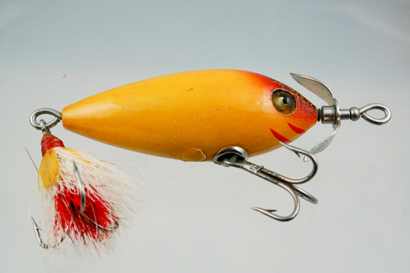 Heddon bucktail surface minnow lure 400 fin and flame for Heddon antique fishing lures